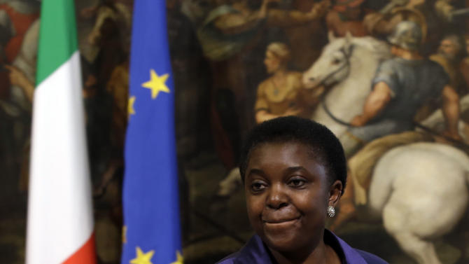 Italian Integration Minister Cecile Kyenge arrives at Chigi palace Premier's office, in Rome, Sunday, April 28, 2013. Two Italian paramilitary police officers were shot and wounded Sunday in a crowded square outside the premier's office in Rome as Italy's new leader and his Cabinet were being sworn in a kilometer (half-mile) away. It was unclear if there was any connection between the events. (AP Photo/Gregorio Borgia)