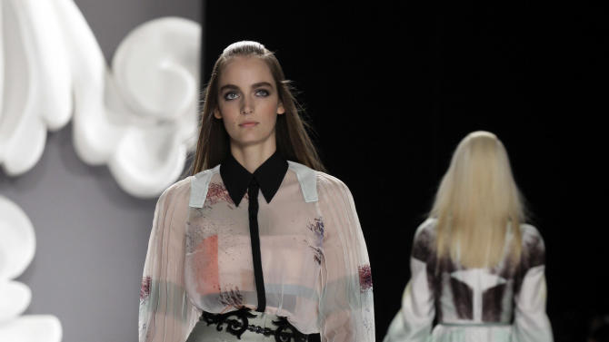 The Carolina Herrera Spring 2013 collection is modeled during Fashion Week in New York,  Monday, Sept. 10, 2012. (AP Photo/Richard Drew)