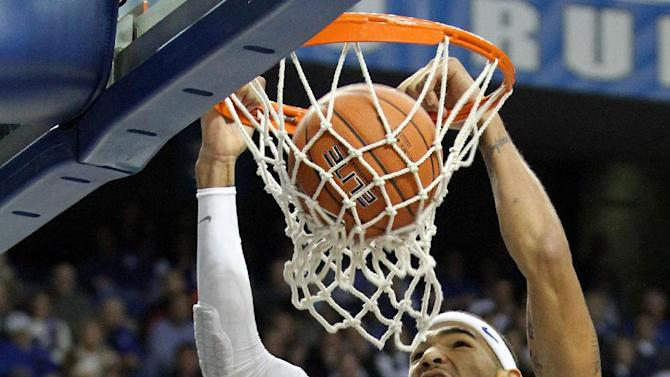 Kentucky's Willie Cauley-Stein (15) dunks in front of Lafayette's Nathaniel Musters (54) during the first half of an NCAA college basketball game at Rupp Arena in Lexington, Ky., Friday, Nov. 16, 2012. (AP Photo/James Crisp)