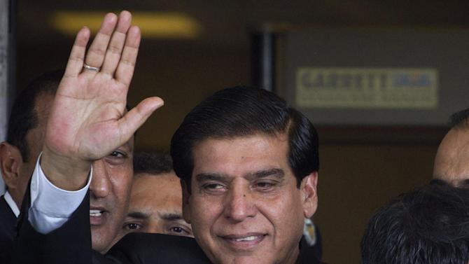 Pakistan's Prime Minister Raja Pervaiz Ashraf waves upon his arrival at the Supreme Court for a hearing in Islamabad, Pakistan on Monday, Aug. 27, 2012. Ashraf appeared at Supreme Court to explain why he has not followed instructions from a panel of judges to reopen an old corruption case against the country's president, Asif Ali Zardari. (AP Photo/Anjum Naveed)