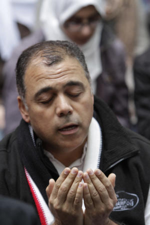 In this Oct. 21, 2011 photo, Ayman El-Sawa, who is originally from Egypt and now lives in Highlands, N.J., prays during Jummah at the Occupy Wall Street encampment in Zuccotti Park, in New York. The Council on American Islamic Relations New York Chapter and the Islamic Leadership Council of Metropolitan New York hosted Friday prayer at Occupy Wall Street. (AP Photo/Mary Altaffer)