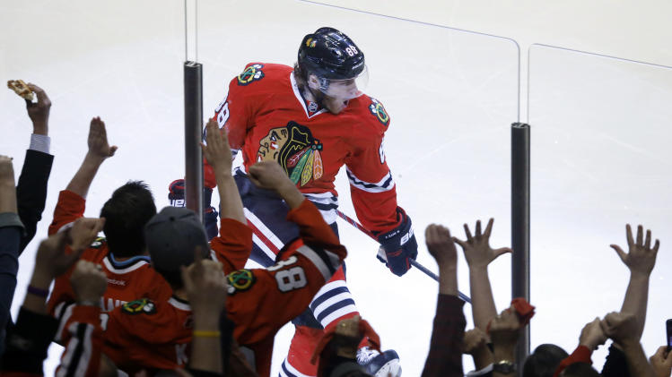 Chicago Blackhawks right wing Patrick Kane (88) reacts after scoring a goal during the first period in Game 5 of the NHL hockey Stanley Cup playoffs Western Conference finals against the Los Angeles Kings, Saturday, June 8, 2013, in Chicago. (AP Photo/Charles Rex Arbogast)