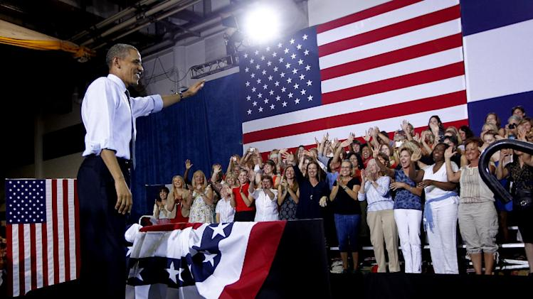President Barack Obama waves to supporters after speaking at a campaign event in Denver, Wednesday, Aug. 8, 2012. (AP Photo/Pablo Martinez Monsivais)