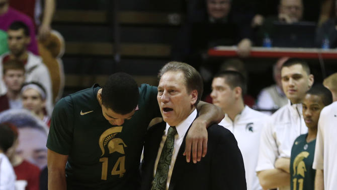 Michigan State head coach Tom Izzo, right, talks with Gary Harris late in the second half of an NCAA college basketball game against Indiana, Sunday, Jan. 27, 2013, in Bloomington, Ind. Indiana defeated Michigan State 75-70. (AP Photo/Darron Cummings)