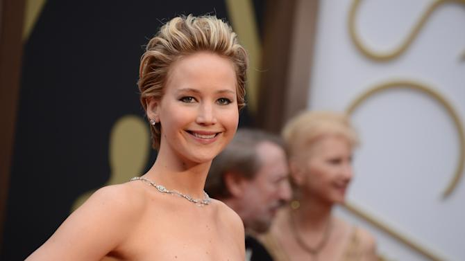 Jennifer Lawrence arrives at the Oscars on Sunday, March 2, 2014, at the Dolby Theatre in Los Angeles. (Photo by Jordan Strauss/Invision/AP)