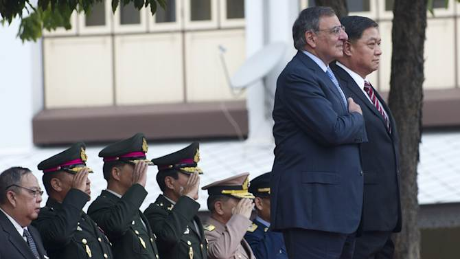 Thai Minister of Defense Sukampol Suwannathat, right, stands alongside U.S. Secretary of Defense Leon Panetta during the playing of the U.S. anthem prior to their meeting at the Ministry of Defense in Bangkok, Thailand, on Thursday, Nov. 15, 2012. (AP Photo/Saul Loeb, Pool)