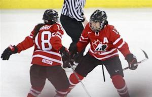 Canada's Ouellette celebrates her goal with Ward during their gold medal game against the U.S. at the IIHF Ice Hockey Women's World Championship in Ottawa