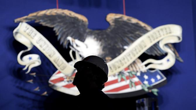 A worker sets up the stage in the Magness Arena at the Daniel L. Ritchie Center for Sports and Wellness, site of Wednesday's presidential debate, on the campus of the University of Denver, Monday, Oct. 1, 2012, in Denver. (AP Photo/Charlie Neibergall)
