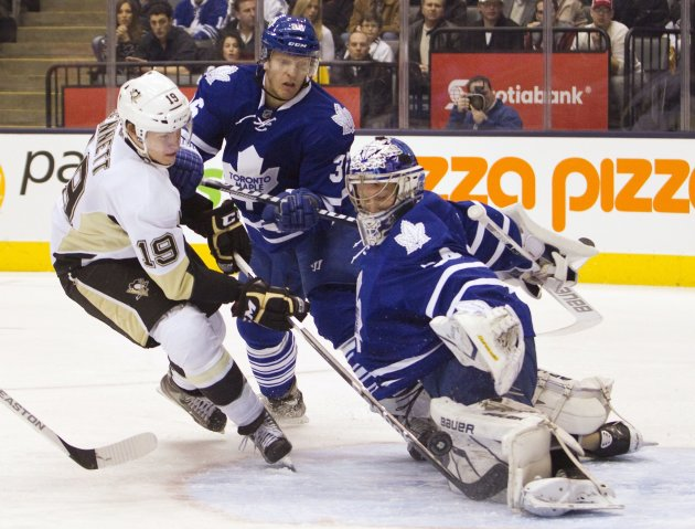 Toronto Maple Leafs' Reimer makes save on Pittsburgh Penguins' Bennett during their NHL hockey game in Toronto