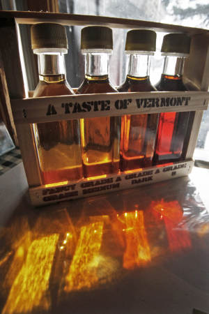 In this Friday, Feb. 15, 2013 photo, four grades of maple syrup are displayed in a gift box in East Montpelier, Vt. Vermont lawmakers are considering whether to drop the state's traditional maple labeling system in favor of an international one. (AP Photo/Toby Talbot)