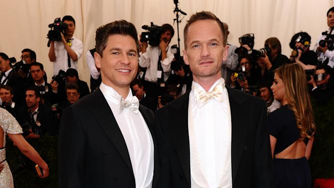 """Neil Patrick Harris, left, and David Burtka arrive at The Metropolitan Museum of Art's Costume Institute benefit gala celebrating """"China: Through the Looking Glass"""" on Monday, May 4, 2015, in New York. (Photo by Charles Sykes/Invision/AP)"""
