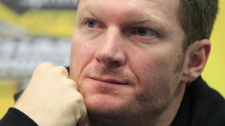 Dale Earnhardt Jr. listens to a question during a news conference prior to his first practice since he recovered from concussions at Martinsville Speedway in Martinsville, Va., Friday, Oct. 26, 2012.  (AP Photo/Steve Helber)