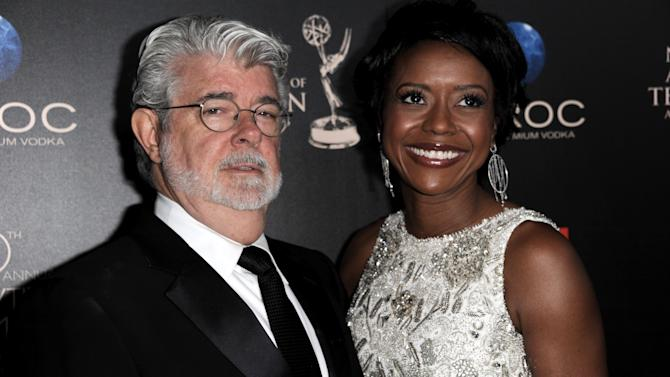 """FILE - In this June 16, 2013 file photo, George Lucas, left, and longtime girlfriend Mellody Hobson arrive at the 40th Annual Daytime Emmy Awards in Beverly Hills, Calif. A Lucasfilm spokeswoman on Monday, June 24, 2013 confirmed the """"Star Wars"""" creator married Hobson in a weekend ceremony at Skywalker Ranch north of San Francisco. (Photo by Richard Shotwell/Invision/AP, File)"""