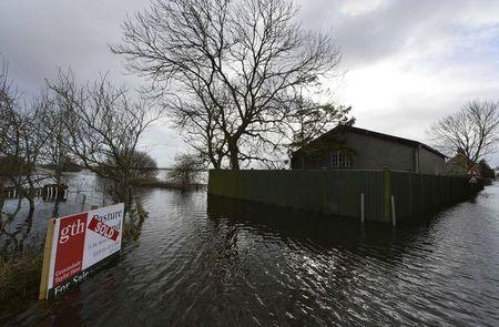 A property is surrounded by flood water in the village of Long Sutton in Somerset in southwest  England