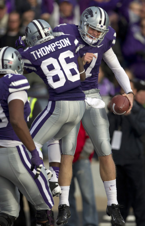 Kansas State quarterback Collin Klein (7) celebrates a touchdown with wide receiver Tramaine Thompson (86) during the second half of an NCAA college football game against Texas Tech in Manhattan, Kan.