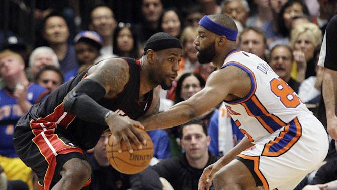 Miami Heat's LeBron James drives past New York Knicks' Baron Davis during the first half of Game 4 of an NBA basketball first-round playoff series at Madison Square Garden, Sunday, May 6, 2012, in New York. (AP Photo/Frank Franklin II)