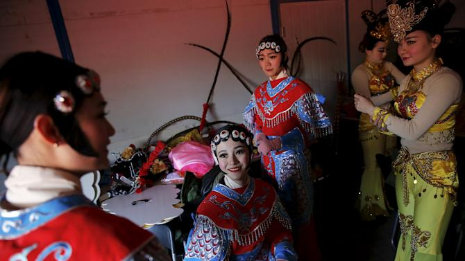 Performers get ready to go onto the stage as the Lunar New Year of the Monkey is celebrated at the temple fair at Ditan Park (the Temple of Earth) in Beijing