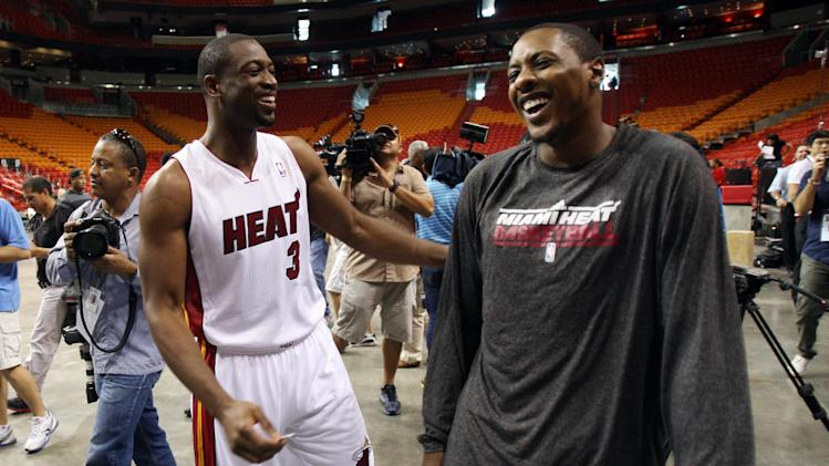 Miami Heat basketball players Dwyane Wade, left, and Mario Chalmers joke around during the team's NBA media day in Miami, Friday, Sept. 28, 2012.  (AP Photo/Wilfredo Lee)