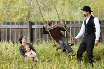 Mary-Louise Parker , Brooklynn Proulx , Dustin Bollinger and Brad Pitt in Warner Bros. Pictures' The Assassination of Jesse James by the Coward Robert Ford
