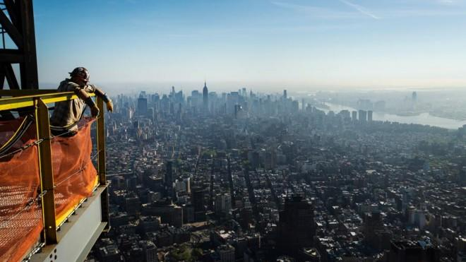An iron worker takes in the view from the nearly complete One World Trade Center on May 10.
