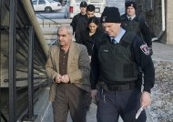 Mohammad Shafia, front,Tooba Yahya, center and Hamed Shafia arrive at the Frontenac County courthouse in Kingston, Ont., Sunday, Jan. 29, 2012. A jury took 15 hours to find Shafia, 58, his wife Tooba Yahya, 42, and their son Hamed, 21, each guilty of four counts of first-degree murder of Mohammad Shafia's three daughters and childless first wife. (AP Photo/The Canadian Press, Graham Hughes)