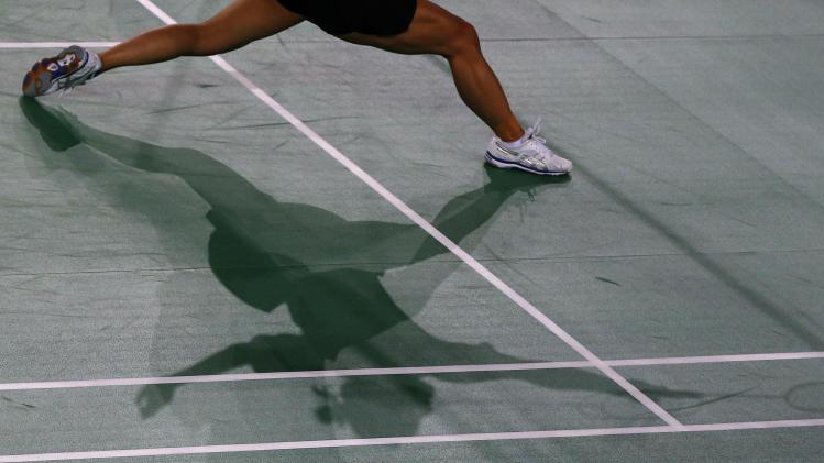 Michelle Chan of New Zealand stretches for shuttlecock during women's Badminton singles match against Elena Johnson of Guernsey at the 2014 Commonwealth Games in Glasgow