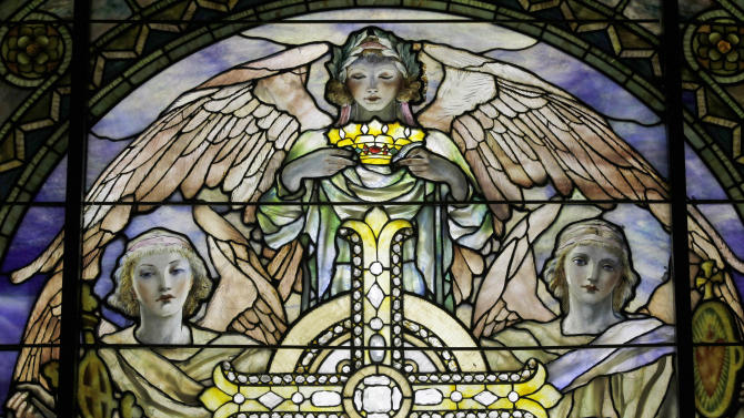 """In this Thursday, Oct. 25 2012 photo,  a detail of """"The Righteous Shall Receive a Crown of Glory,"""" Brainard Memorial Window for Methodist Church, Waterville, New York, ca. 1901 is photographed while on display at the """"Louis C. Tiffany and the Art of Devotion"""" exhibit at the Museum of Biblical Art in New York.  (AP Photo/Mary Altaffer)"""