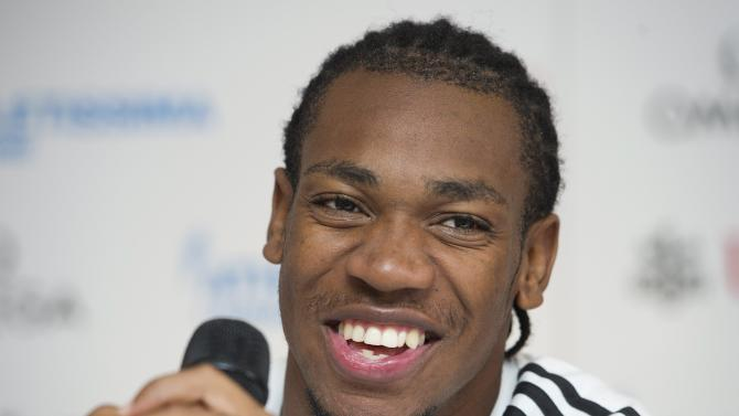 Jamaica's Olympic champion Yohan Blake smiles during a press conference on the eve of the Diamond League Athletissima international Athletics meeting, in Lausanne, Switzerland, Wednesday, Aug. 22, 2012. (AP Photo/Keystone, Jean-Christophe Bott)