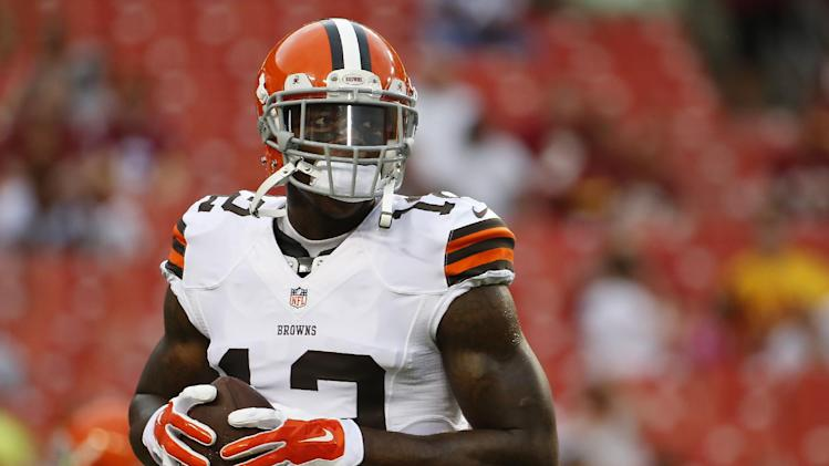 FILE - In this Aug. 18, 2014, file photo, Cleveland Browns wide receiver Josh Gordon (12) warms up before an NFL preseason football game against the Washington Redskins in Landover, Md. Gordon has been suspended by the NFL one year for violating the league's substance abuse policy. Gordon's suspension is effective immediately and he will miss the entire 2014 season. (AP Photo/Evan Vucci, File)
