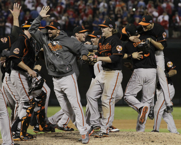The Baltimore Orioles celebrate winning the American League wild-card playoff baseball game against the Texas Rangers, 5-1, Friday, Oct. 5, 2012 in Arlington, Texas. (AP Photo/Tony Gutierrez)