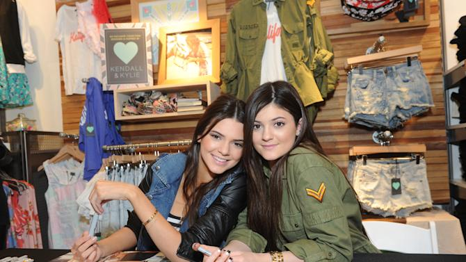 Kylie, right, and Kendall Jenner launch their exclusive Kendall & Kylie collection at PacSun, Friday, February 8, 2013, on Long Island, New York.   (Photo by Diane Bondareff/Invision for PacSun)