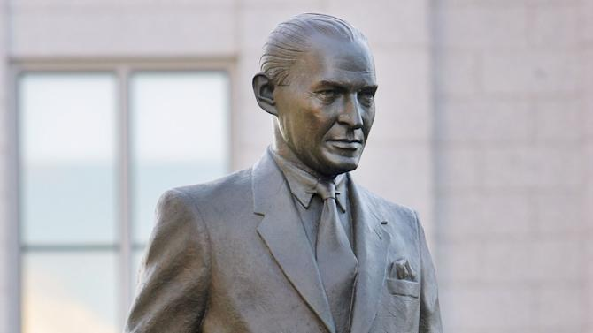 A statue of Marriner S. Eccles is unveiled Tuesday, Sept. 16, 2014, during a ceremony at the Utah State Capitol in Salt Lake City.  Eccles, a former Federal Reserve chairman and Utah banker,  is credited with helping the country through the Great Depression.  (AP Photo/The Deseret News, Scott G Winterton)  SALT LAKE TRIBUNE OUT;  MAGS OUT