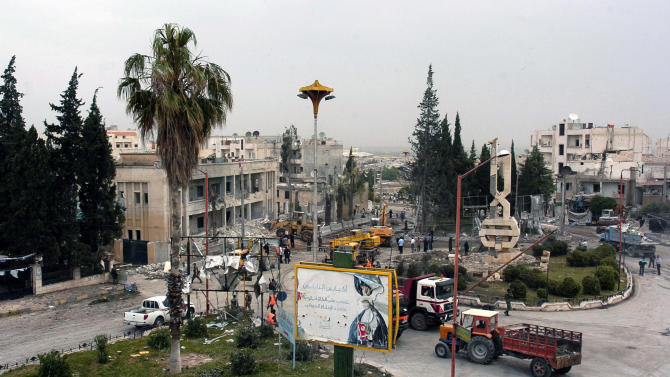 In this photo released by the Syrian official news agency SANA, a general view shows the site where one of two bombs exploded near a military compound, in the city of Idlib, northwestern Syria, Monday, April 30, 2012. Two powerful bombs exploded near a military compound in the northwestern Syrian city of Idlib on Monday, killing several people and causing heavy damage, Syrian state media and opposition activists said. (AP Photo/SANA)