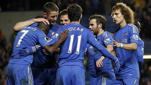 Chelsea players celebrate a goal against Manchester United (AFP)