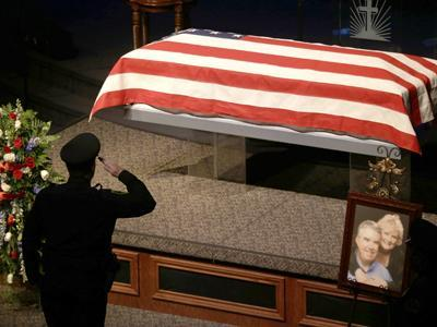 DA, Wife Mourned; Search for Killers Continues