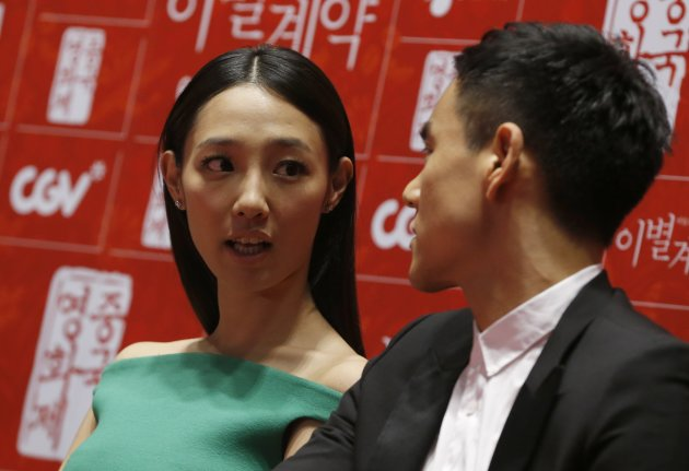 "Cast members Bai and Peng attend news conference to promote their movie ""A Wedding Invitation"", the closing film of the Chinese Film Festival, in Seoul"