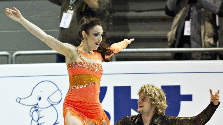 Meryl Davis and Charlie White of the United States perform their short program in the ice dance competition at the Grand Prix of Figure Skating, Friday, Dec. 9, 2011 in Quebec City. (AP Photo/The Canadian Press, Jacques Boissinot)
