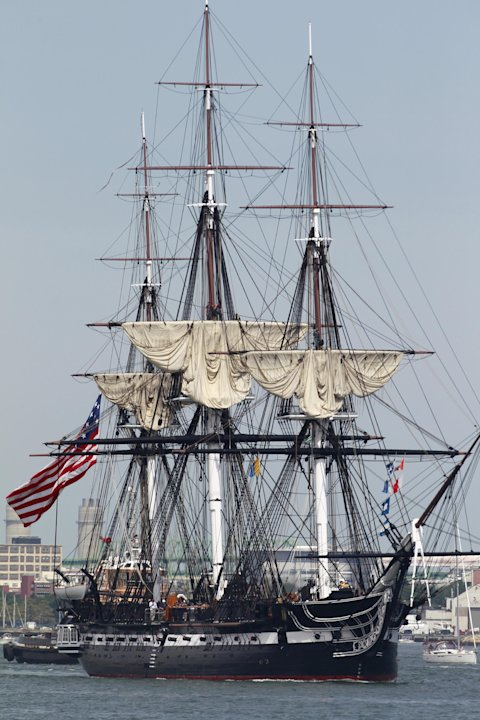 The USS Constitution is escorted by a tugboat in Boston Harbor in Boston, Sunday, Aug. 19, 2012. The USS Constitution, the U.S. Navy's oldest commissioned war ship, sailed under her own power during t