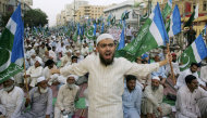 A supporter of the Pakistani religious party Jamaat-e-Islami shouts during a rally against drone attacks Saturday, June 4, 2011 in Karachi, Pakistan. Ilyas Kashmiri, a top al-Qaida commander and possible replacement for Osama bin Laden who is accused of the 2008 Mumbai massacre, was killed in an American drone-fired missile strike close to the Afghan border, a fax from the militant group he heads and a Pakistani intelligence official said Saturday.