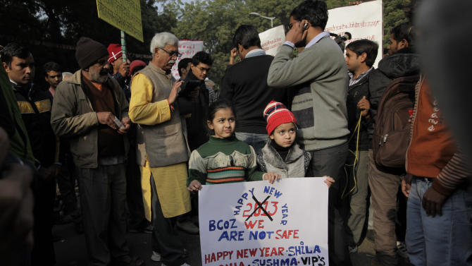 Young Indian girls hold a placard as they participate in a protest in New Delhi, India, Monday, Dec. 31, 2012. The gang-rape and killing of a New Delhi student has set off an impassioned debate about what India needs to do to prevent such a tragedy from happening again. The country remained in mourning Monday, two days after the 23-year-old physiotherapy student died from her internal wounds in a Singapore hospital. (AP Photo/Manish Swarup)