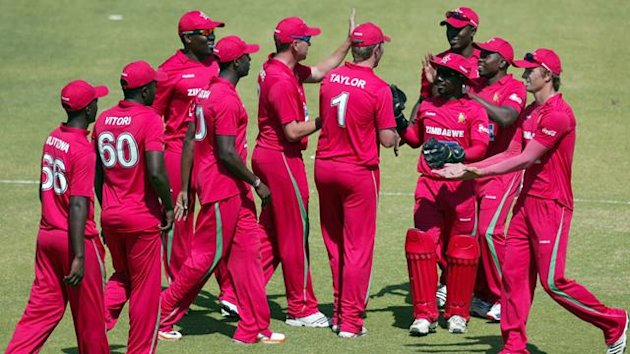 Zimbabwe's players celebrate the last Bangladeshi wicket
