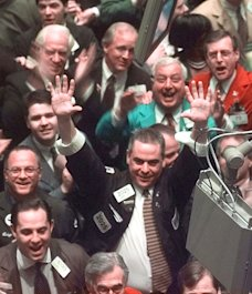 Traders cheer at NYSE, March 1999 file photo: Credit AP