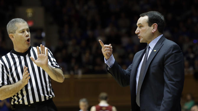 Duke head coach Mike Krzyzewski speaks with an official during the second half of an NCAA college basketball game against Boston College in Durham, N.C., Sunday, Feb. 24, 2013. Duke won 89-68. (AP Photo/Gerry Broome)
