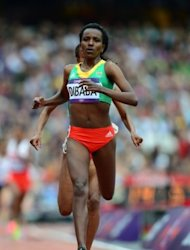 Ethiopia&#39;s Tirunesh Dibaba Kenene competes in the women&#39;s 5000m heats at the athletics event during the London 2012 Olympic Games, on August 7. Dibaba will bid to add to her remarkable medals collection by retaining her 5,000m title to complete the Olympic double for a second time