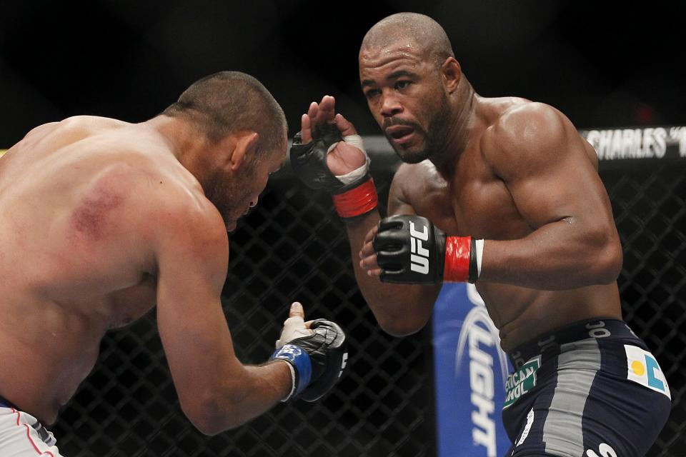 Rashad Evans (R) and Dan Henderson during UFC 161 in Winnipeg, Manitoba on Saturday June 15, 2013.  (AP Photo/The Canadian Press, John Woods)