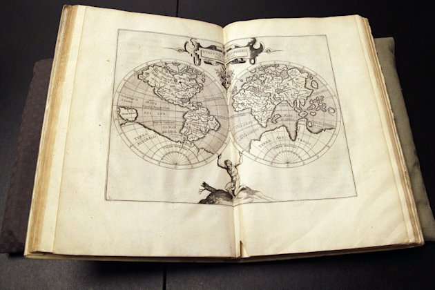 The world map page of the  Wytfliet Atlas is on display during a news conference, Wednesday, June 27, 2012 in New York.  The Wytfliet Atlas stolen a decade ago from the Royal Library of Sweden has bee
