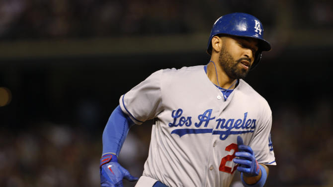 Los Angeles Dodgers' Matt Kemp circles the bases after hitting a solo home run against the Colorado Rockies in the ninth inning of the Dodgers' 10-8 victory in a baseball game in Denver on Wednesday, July 3, 2013. (AP Photo/David Zalubowski)