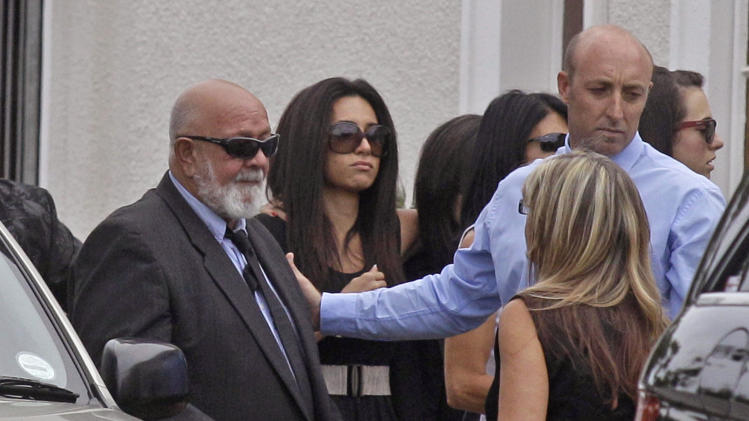 Barry Steenkamp, left, the father of Reeva Steenkamp, attends her funeral in Port Elizabeth, South Africa, Tuesday, Feb. 19, 2013. Olympic athlete Oscar Pistorius is charged with the premeditated murder of Steenkamp on Valentine's Day. The defense lawyer says it was an accidental shooting. (AP Photo/Schalk van Zuydam)