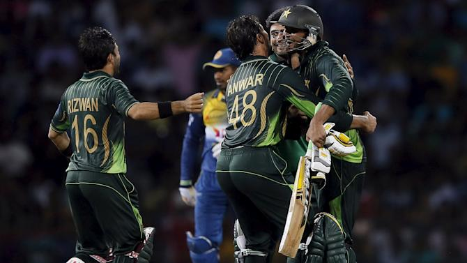 Pakistan's Wasim celebrates with his teammates after they won their second Twenty 20 cricket match against Sri Lanka in Colombo