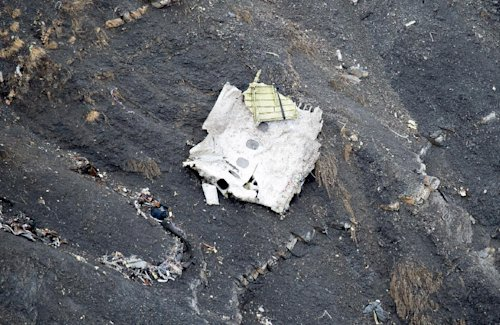 This photo provided by the Gendarmerie Nationale shows debris of the crashed Germanwings passenger jet scattered on the mountain side near Seyne-les-A...